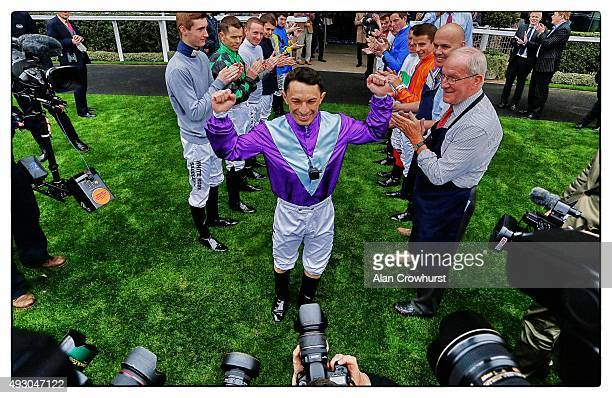 A guard of honour for jockey Silvestre De Sousa champion flat jockey for 2016 at Ascot racecourse on October 17 2015 in Ascot England