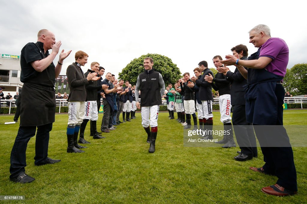 A guard of honour is formed for Richard Johnson who is crowned Champion Jockey at Sandown Park on April 29, 2017 in Esher, England.
