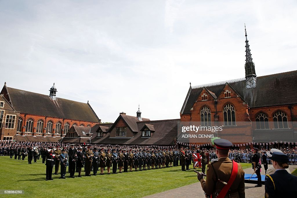 A Guard of Honour waits to be inspected by Britain's Queen Elizabeth II, during her visit to Berkhamsted School, north-west of London on May 6, 2016, on the 475th Anniversary of its foundation. The Queen, in her role as Patron of the school, will inspect a Guard of Honour formed from the school's Combined Cadet Force, and view displays celebrating various aspects of school life. Berkhamsted School was founded in 1541 by John Incent, Dean of St Paul's, initially as a school of just 144 pupils. Berkhamsted Schools Group is currently responsible for the education of over 1,800 pupils. / AFP / ADRIAN