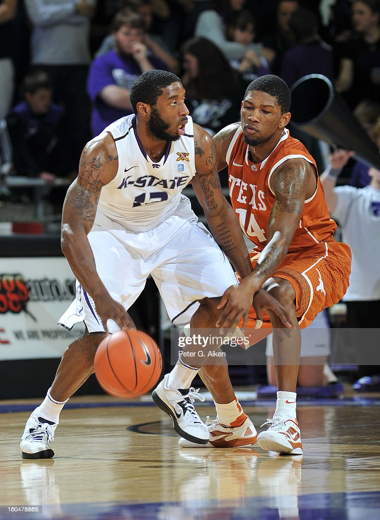 Guard Omari Lawrence #12 of the Kansas State Wildcats drives against guard Julien Lewis #14 of the Texas Longhorns during the first half on January 30, 2013 at Bramlage Coliseum in Manhattan, Kansas.