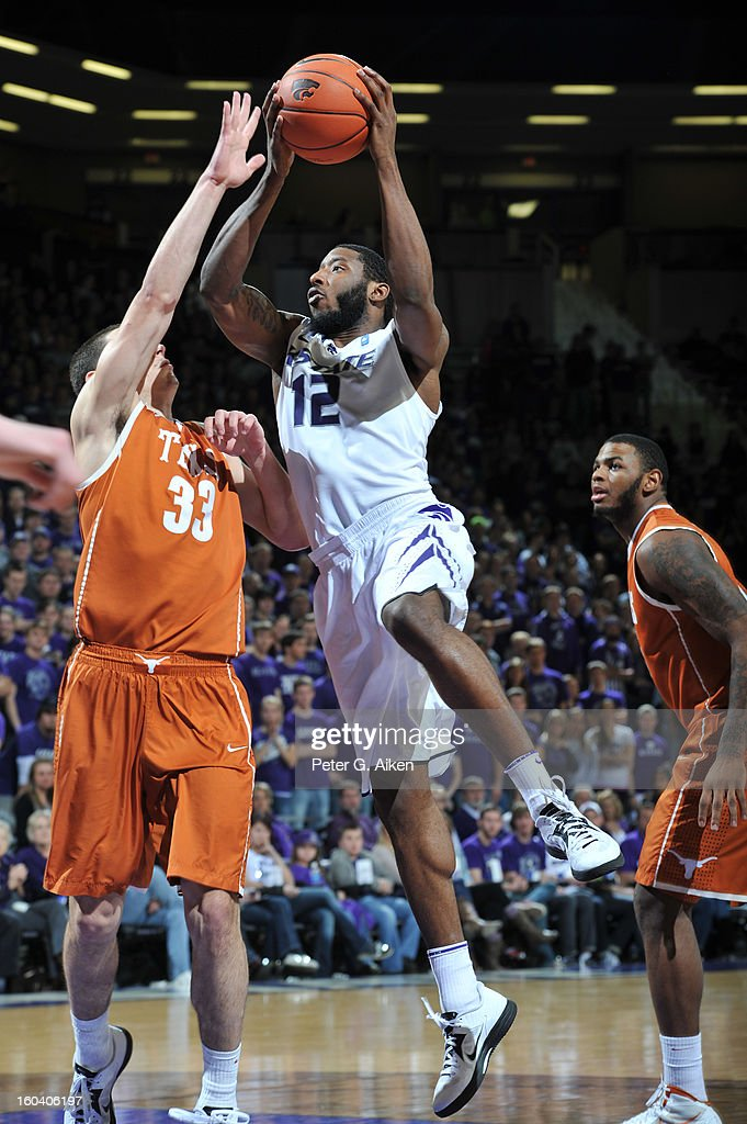 Guard Omari Lawrence #12 of the Kansas State Wildcats drives to the basket against forward Ioannis Papapetrou #33 of the Texas Longhorns during the second half on January 30, 2013 at Bramlage Coliseum in Manhattan, Kansas. Kansas State defeated Texas 83-57.