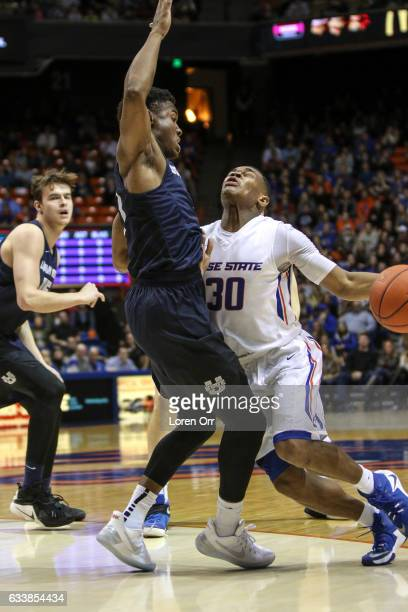 Guard Paris Austin of the Boise State Broncos runs right into the defense of guard Koby McEwen of the Utah State Aggies during second half action on...