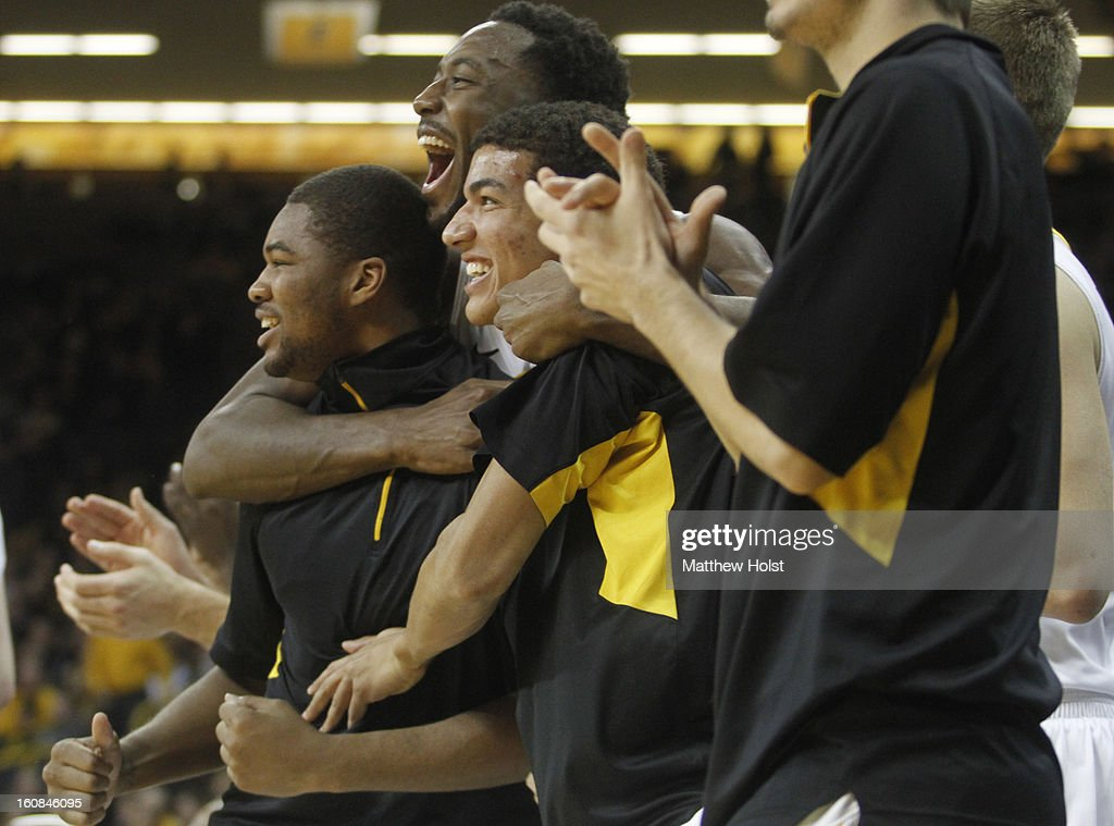 Guard Pat Ingram #24, left, center Gabriel Olaseni #0, center, and forward Darius Stokes #35 of the Iowa HAwkeyes celebrate on the bench during the first half as they pull ahead of the Penn State Nittany Lions on January 31, 2013 at Carver-Hawkeye Arena in Iowa City, Iowa. Iowa won 76-67.