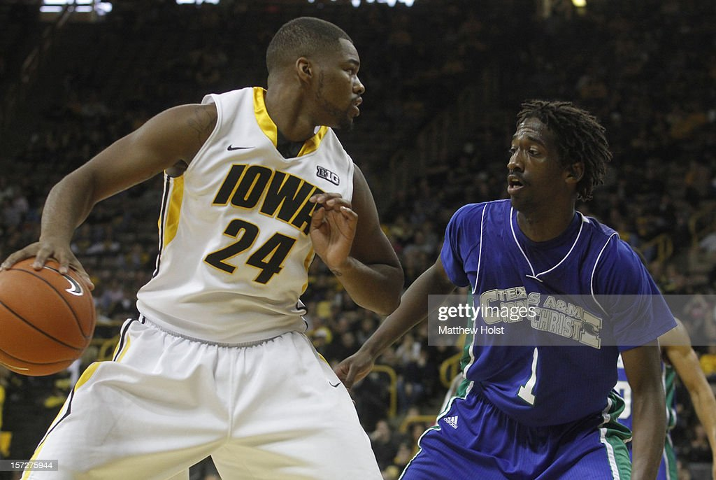 Guard Pat Ingram #24 of the Iowa Hawkeyes dribbles up the court during the second half in front of guard Hameed Alli #1 of the Texas A&M Corpus Christi Islanders on December 1, 2012 at Carver-Hawkeye Arena in Iowa City, Iowa. Iowa defeated Texas A&M Corpus Christi 88-59.