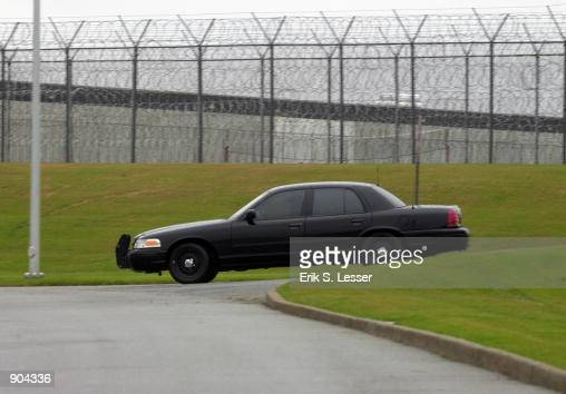 A guard patrols the fence line at the Georgia Diagnostic Prison March 12 2002 in Jackson GA British national Tracy Housel is scheduled to be executed...