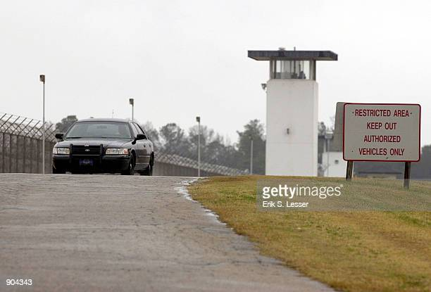 A guard patrols the fence line at the Georgia Diagnostic Prison March 12 2002 in Jackson GA British national Tracy Housel was executed by lethal...