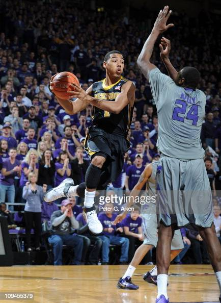 Guard Phil Pressey of the Missouri Tigers drives to the basket against forward Curtis Kelly of the Kansas State Wildcats during the first half on...