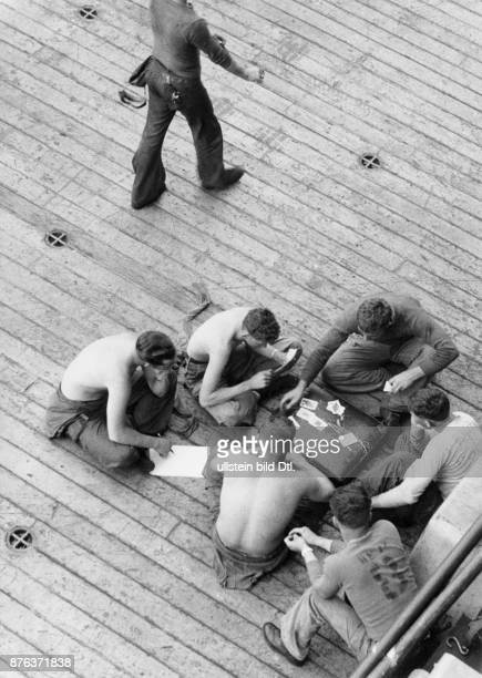 Guard playing cards on the deck of the aircraft carrier USS Hancock Claude Jacoby
