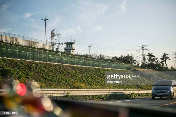 A guard post stands next to transmission towers near the temporarily suspended construction site of the ShinKori No 5 and 6 nuclear power reactors...