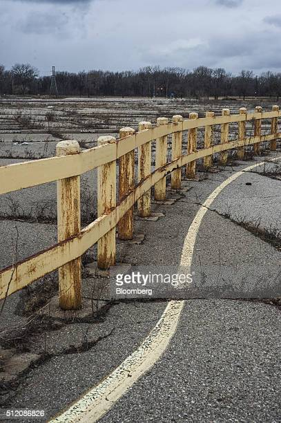 Guard rails stand at the former site of the General Motors Co powertrain plant inside the Willow Run airport in Ypsilanti Michigan US on Wednesday...
