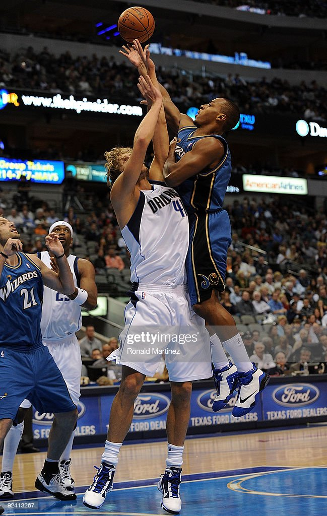 Guard Randy Foye #15 of the Washington Wizards takes a shot against Dirk Nowitzki #41 of the Dallas Mavericks during the season opener on October 27, 2009 at American Airlines Center in Dallas, Texas.