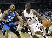 Guard Raymond Felton of the Charlotte Bobcats dribbles with the ball while guard Jameer Nelson of the Orlando Magic defends him during Game Three of...