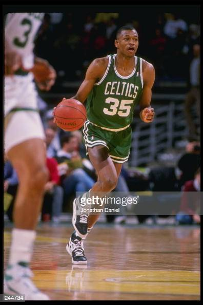 Guard Reggie Lewis of the Boston Celtics dribbles the ball down the court during a game against the Milwaukee Bucks at the Bradley Center in...