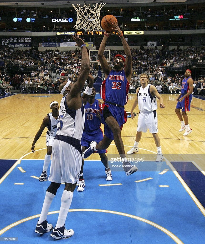 Guard Richard Hamilton #32 of the Detroit Pistons drives to the hoop against Erick Dampier #25 of the Dallas Mavericks at the American Airlines Center on December 7, 2006 in Dallas, Texas.