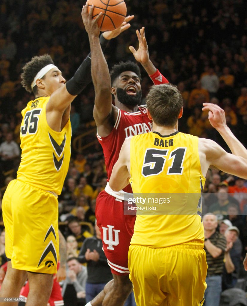 Guard Robert Johnson #4 of the Indiana Hoosiers goes to the basket during the second half between forwards Cordell Pemsl #35 and Nicholas Baer #51 of the Iowa Hawkeyes on February 17, 2018 at Carver-Hawkeye Arena, in Iowa City, Iowa.