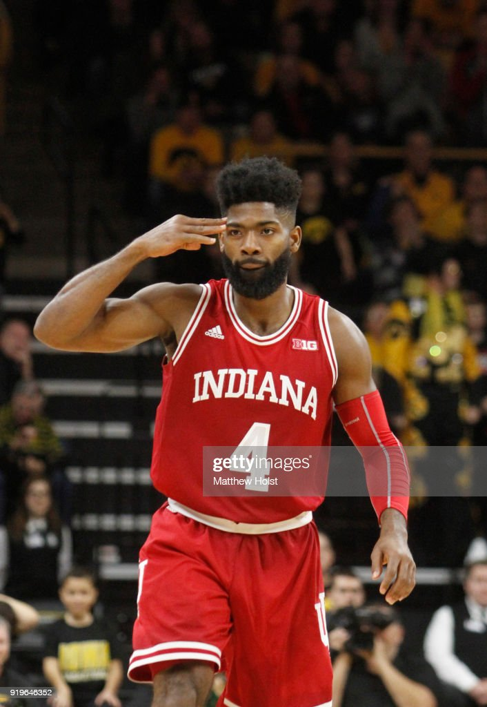 Guard Robert Johnson #4 of the Indiana Hoosiers salutes his bench after a 3-pointer during the second half against the Iowa Hawkeyes on February 17, 2018 at Carver-Hawkeye Arena, in Iowa City, Iowa.