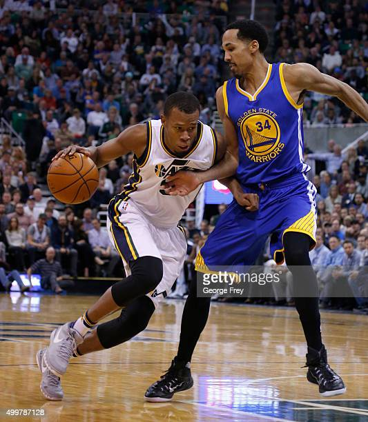 Guard Rodney Hood of the Utah Jazz drives to the basket on Golden State Warriors guard Shaun Livingston during the second half of an NBA game...