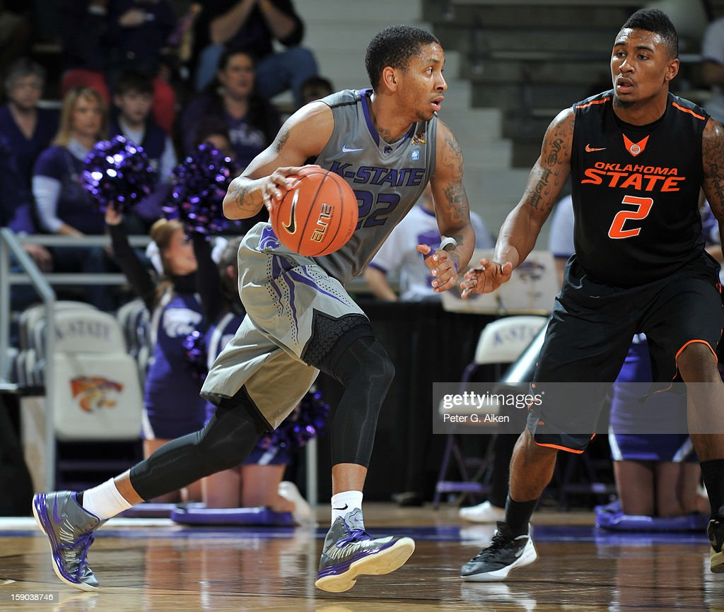 Guard Rodney McGruder #22 of the Kansas State Wildcats drives against guard Le'Bryan Nash #2 of the Oklahoma State Cowboys during the first half on January 5, 2013 at Bramlage Coliseum in Manhattan, Kansas.