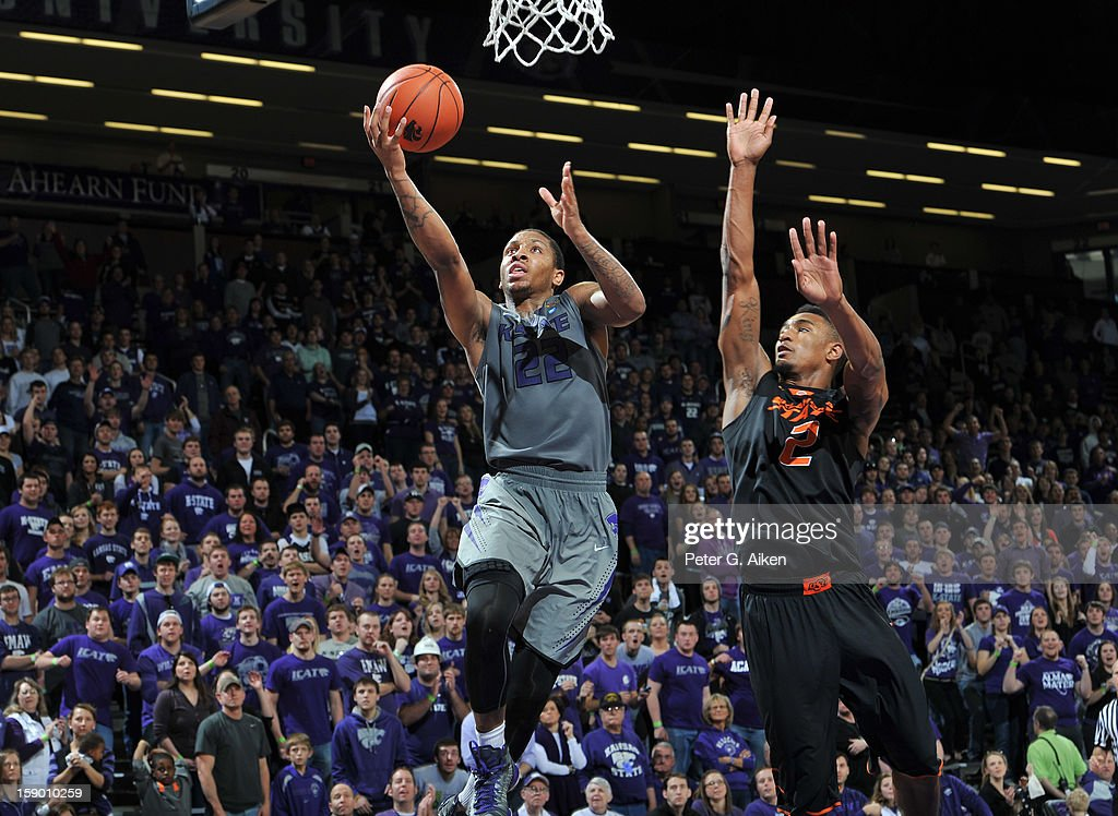 Guard Rodney McGruder #22 of the Kansas State Wildcats drives to the basket against guard Le'Bryan Nash #2 of the Oklahoma State Cowboys during the second half on January 5, 2013 at Bramlage Coliseum in Manhattan, Kansas. Kansas State defeated Oklahoma State 73-67.