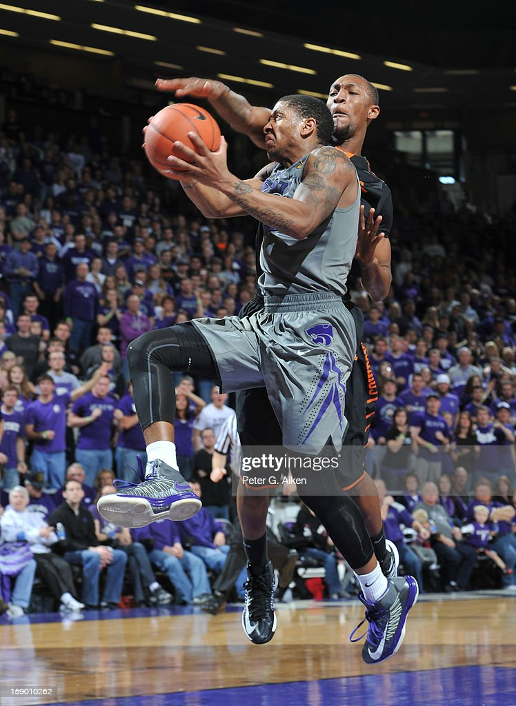 Guard Rodney McGruder #22 of the Kansas State Wildcats drives to the basket against the Oklahoma State Cowboys during the second half on January 5, 2013 at Bramlage Coliseum in Manhattan, Kansas. Kansas State defeated Oklahoma State 73-67.