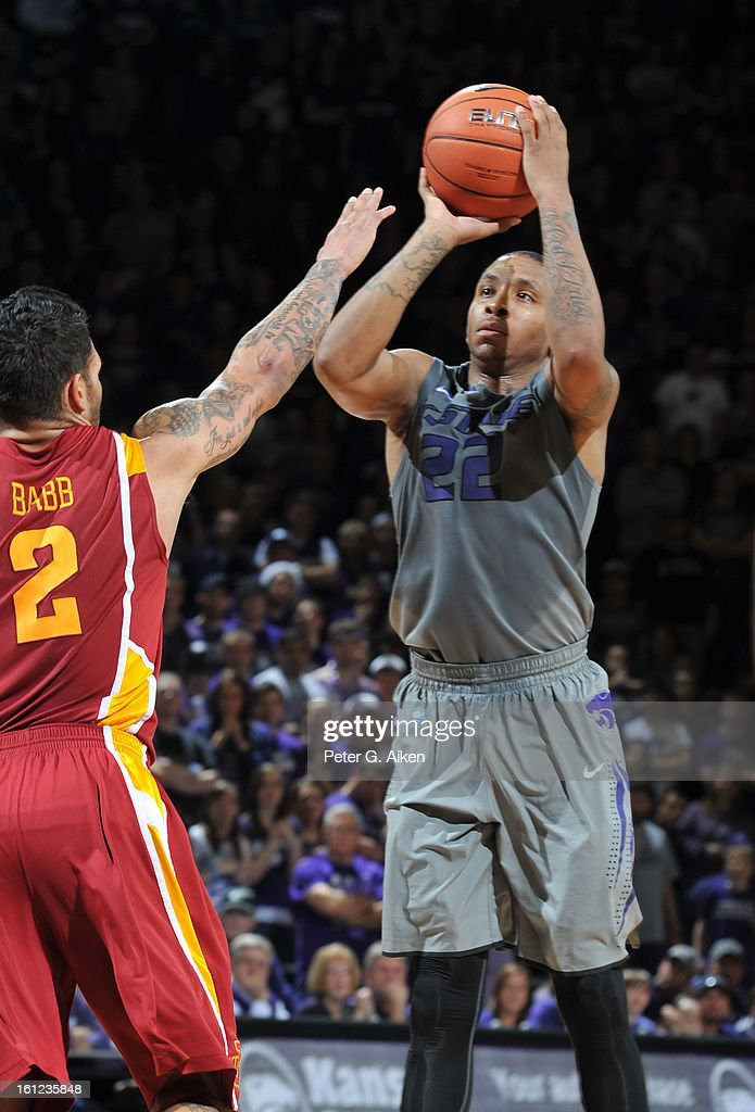 Guard Rodney McGruder #22 of the Kansas State Wildcats hits a three-point shot over guard Chris Babb #2 of the Iowa State Cyclones during the second half on February 9, 2013 at Bramlage Coliseum in Manhattan, Kansas. Kansas State defeated Iowa State 79-70.