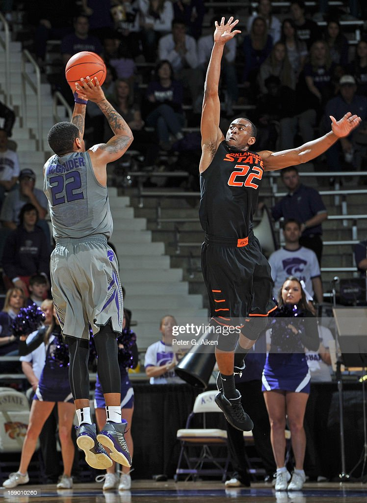Guard Rodney McGruder #22 of the Kansas State Wildcats puts up a shot against guard Markel Brown #22 of the Oklahoma State Cowboys during the first half on January 5, 2013 at Bramlage Coliseum in Manhattan, Kansas.