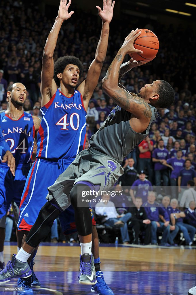 Guard Rodney McGruder of the Kansas State Wildcats puts up a shot against forward Kevin Young of the Kansas Jayhawks during the second half on...