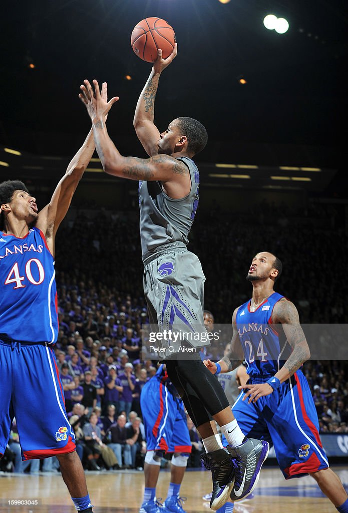 Guard Rodney McGruder #22 of the Kansas State Wildcats puts up a shot over forward Kevin Young #40 of the Kansas Jayhawks during the second half on January 22, 2013 at Bramlage Coliseum in Manhattan, Kansas. Kansas defeated Kansas State 59-55.