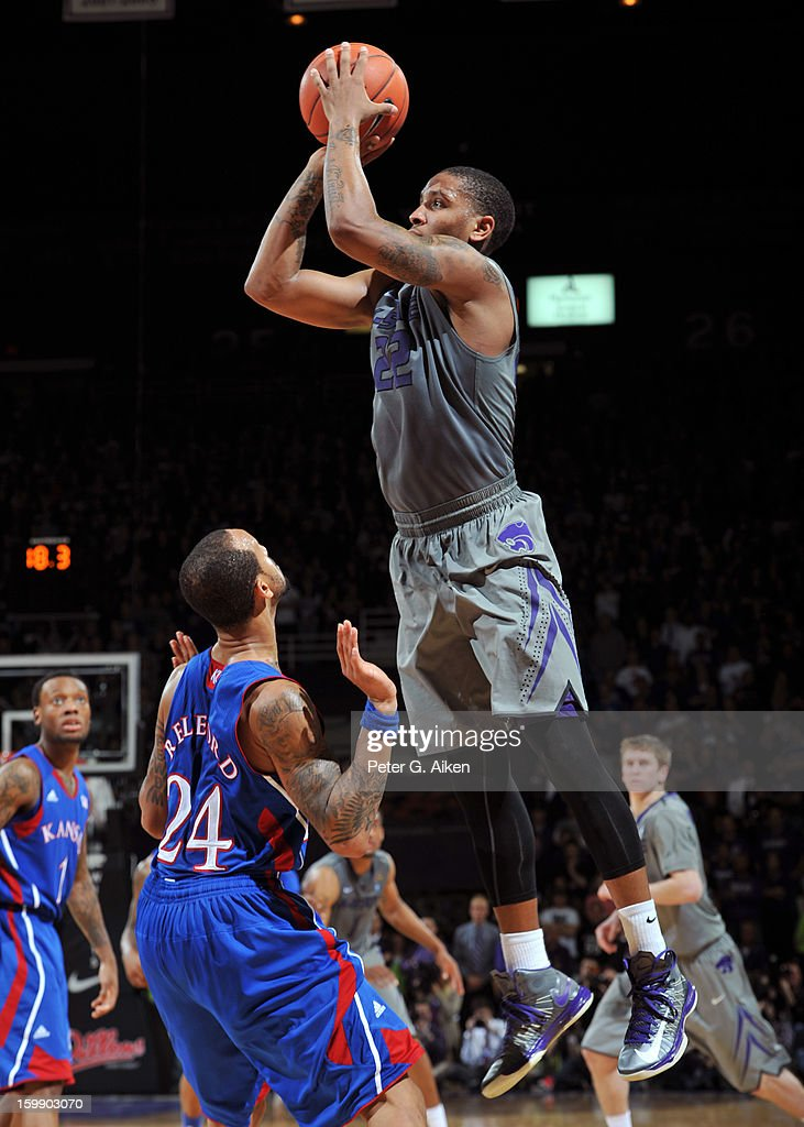 Guard Rodney McGruder #22 of the Kansas State Wildcats puts up a shot over guard <a gi-track='captionPersonalityLinkClicked' href=/galleries/search?phrase=Travis+Releford&family=editorial&specificpeople=5628041 ng-click='$event.stopPropagation()'>Travis Releford</a> #24 of the Kansas Jayhawks during the second half on January 22, 2013 at Bramlage Coliseum in Manhattan, Kansas. Kansas defeated Kansas State 59-55.