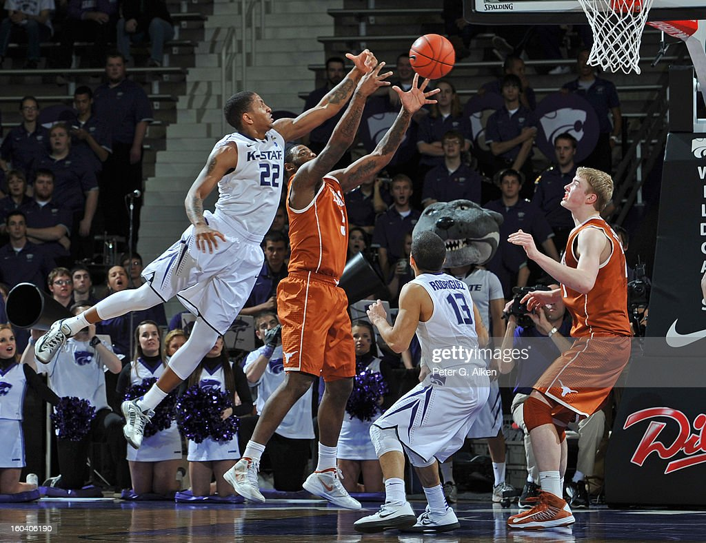 Guard Rodney McGruder #22 of the Kansas State Wildcats reaches for the ball over forward Jaylen Bond #5 of the Texas Longhorns during the second half on January 30, 2013 at Bramlage Coliseum in Manhattan, Kansas. Kansas State defeated Texas 83-57.