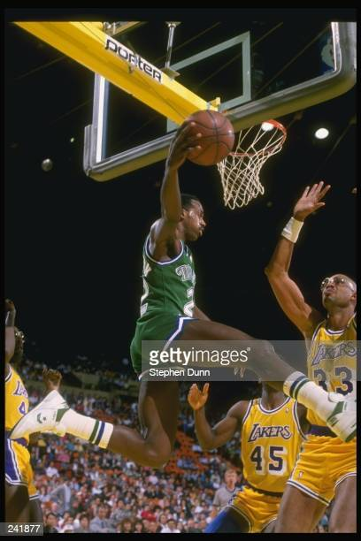 Guard Rolando Blackman of the Dallas Mavericks goes up for two as center Kareem AbdulJabbar of the the Los Angeles Lakers tries to block the shot...