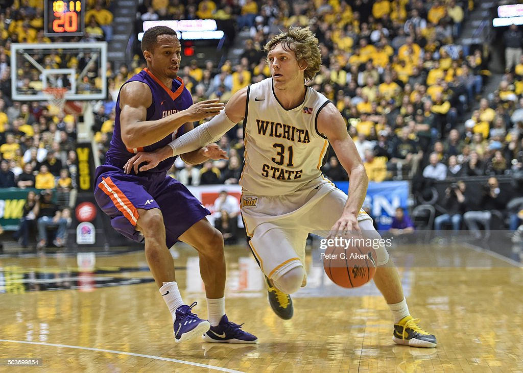 Guard <a gi-track='captionPersonalityLinkClicked' href=/galleries/search?phrase=Ron+Baker+-+Basketball+Player&family=editorial&specificpeople=13909614 ng-click='$event.stopPropagation()'>Ron Baker</a> #31 of the Wichita State Shockers drives against guard Jaylon Brown #3 of the Evansville Aces during the first half on January 6, 2016 at Charles Koch Arena in Wichita, Kansas.