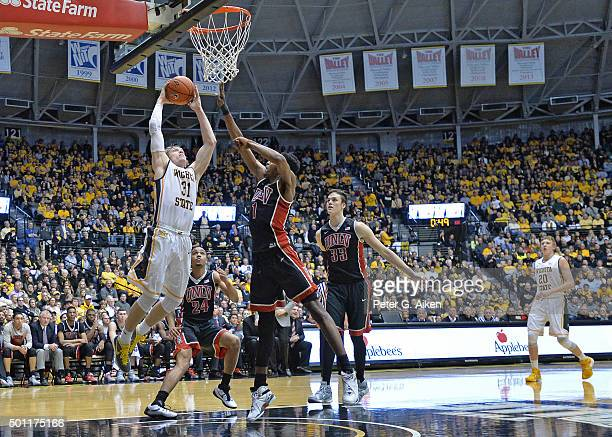Guard Ron Baker of the Wichita State Shockers drives in for a score against forward Derrick Jones Jr #1 of the UNLV Rebels during the first half on...