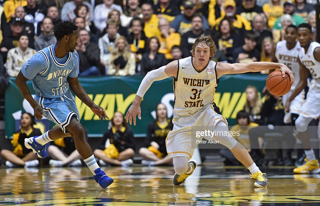 Guard Ron Baker of the Wichita State Shockers grabs a loose ball against guard Everett Clemons of the Indiana State Sycamores during the first half...
