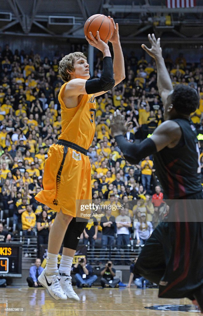 Guard Ron Baker #31 of the Wichita State Shockers hits a three-point shot against the Southern Illinois Salukis during the second half on February 11, 2014 at Charles Koch Arena in Wichita, Kansas. Wichita State won 78-67.
