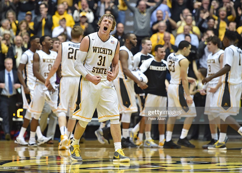 Guard Ron Baker #31 of the Wichita State Shockers reacts after a scoring run against the UNLV Rebels during the first half on December 9, 2015 at Charles Koch Arena in Wichita, Kansas.