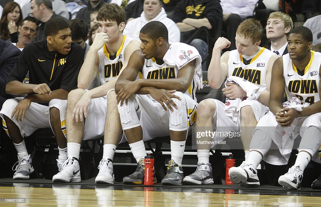 Guard Roy Devyn Marble #4, center Adam Woodbury #34, forward Melsahn Basabe #1, guard Mike Gesell #10 and guard Pat Ingram #24 of the Iowa Hawkeyes sit on the bench during the first half against the Michigan State Spartans on January 10, 2013 at Carver-Hawkeye Arena in Iowa City, Iowa. Michigan State won 62-59.