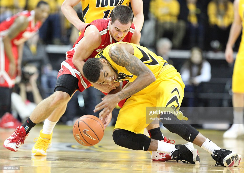 Guard Roy Devyn Marble #4 of the Iowa Hawkeyes battles for a loose ball during the first half against guard <a gi-track='captionPersonalityLinkClicked' href=/galleries/search?phrase=Aaron+Craft&family=editorial&specificpeople=7348782 ng-click='$event.stopPropagation()'>Aaron Craft</a> #4 of the Ohio State Buckeyes on February 4, 2014 at Carver-Hawkeye Arena, in Iowa City, Iowa.
