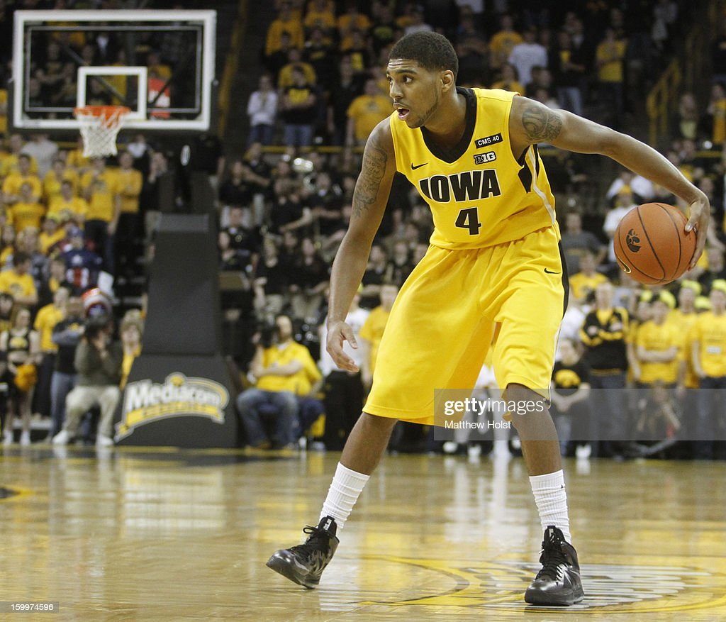 Guard Roy Devyn Marble #4 of the Iowa Hawkeyes brings the ball down the court during the second half against the Wisconsin Badgers on January 19, 2013 at Carver-Hawkeye Arena in Iowa City, Iowa. Iowa won 70-66.