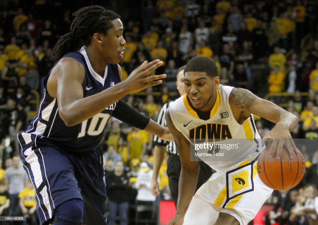 Guard Roy Devyn Marble #4 of the Iowa Hawkeyes drives down the court during the second half in front of forward Brandon Taylor #10 of the Penn State Nittany Lions on January 31, 2013 at Carver-Hawkeye Arena in Iowa City, Iowa.