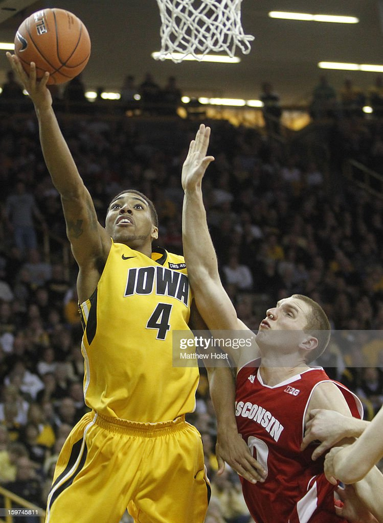 Guard Roy Devyn Marble #4 of the Iowa Hawkeyes drives to the basket during the second half against forward Jared Berggren #40 of the Wisconsin Badgers on January 19, 2013 at Carver-Hawkeye Arena in Iowa City, Iowa. Iowa won 70-66.