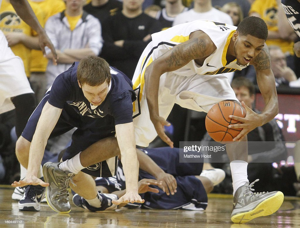 Guard Roy Devyn Marble #4 of the Iowa Hawkeyes grabs a loose ball in the first half in front of forward Donovan Jack #5 of the Penn State Nittany Lions on January 31, 2013 at Carver-Hawkeye Arena in Iowa City, Iowa.