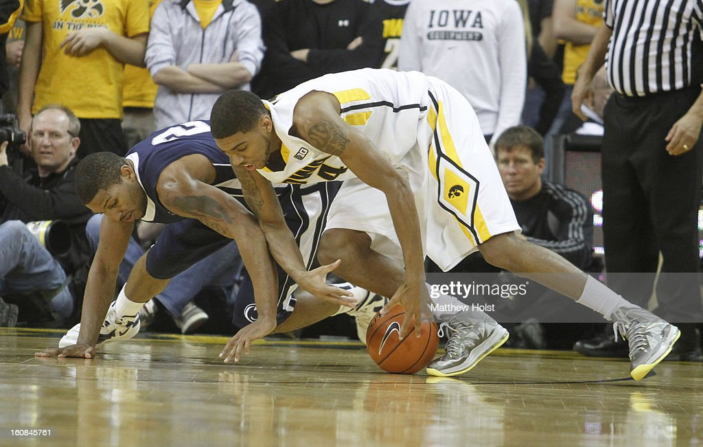 Guard Roy Devyn Marble #4 of the Iowa Hawkeyes grabs a loose ball in the first half in front of guard D.J. Newbill #2 of the Penn State Nittany Lions on January 31, 2013 at Carver-Hawkeye Arena in Iowa City, Iowa.