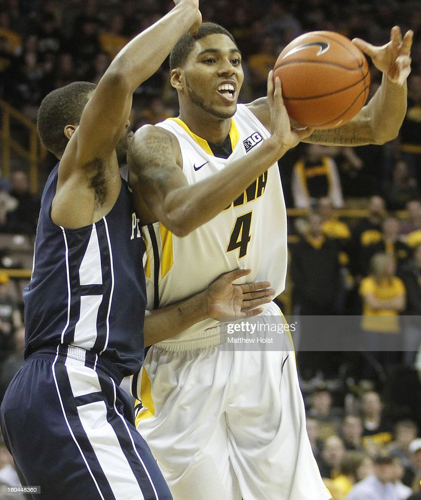 Guard Roy Devyn Marble #4 of the Iowa Hawkeyes passes the ball down the court during the second half in front of guard D.J. Newbill #2 of the Penn State Nittany Lions on January 31, 2013 at Carver-Hawkeye Arena in Iowa City, Iowa.