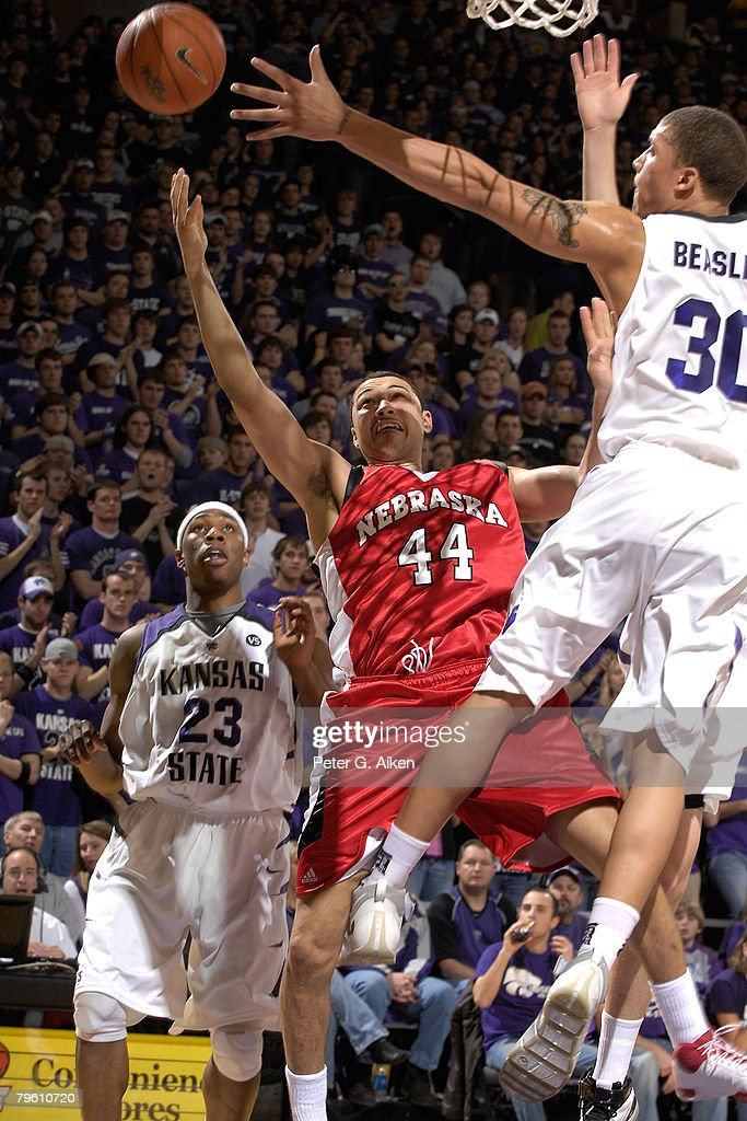 Guard Ryan Anderson of the Nebraska Cornhuskers puts up a shot against pressure from Forward Michael Beasley of the Kansas State Wildcats in the...