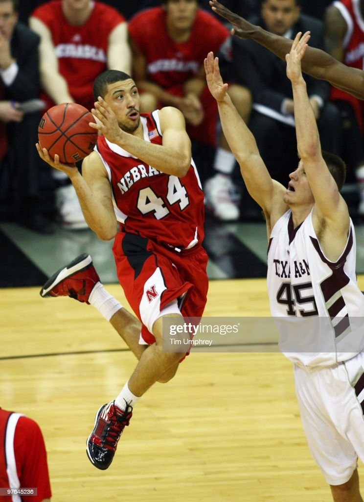 Guard Ryan Anderson of the Nebraska Cornhuskers shoots over forward Nahtan Walkup of the Texas AM Aggies at the Sprint Center on March 11 2010 in...