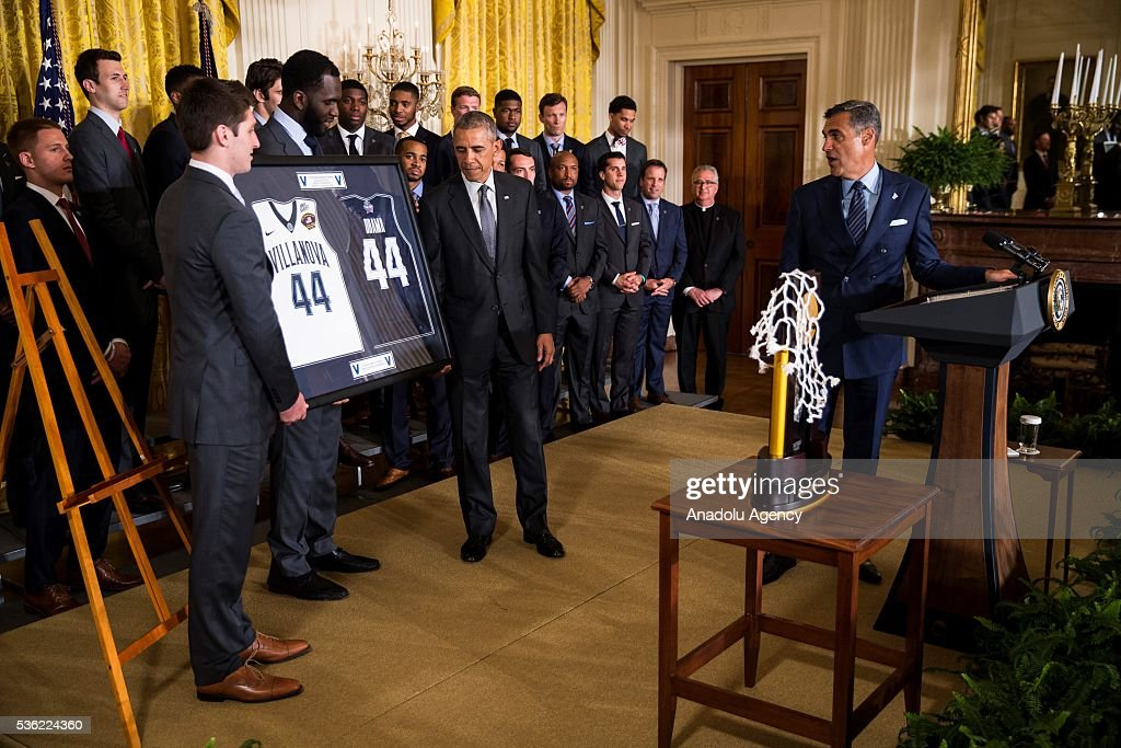 Guard Ryan Arcidiacono and Forward Daniel Ochefu present President Obama with a customized jerseys during a ceremony honoring the 2016 NCAA Champion's, the Villanova Wildcats mens basketball team, in the East Room of the White House in Washington, USA on May 31, 2016.