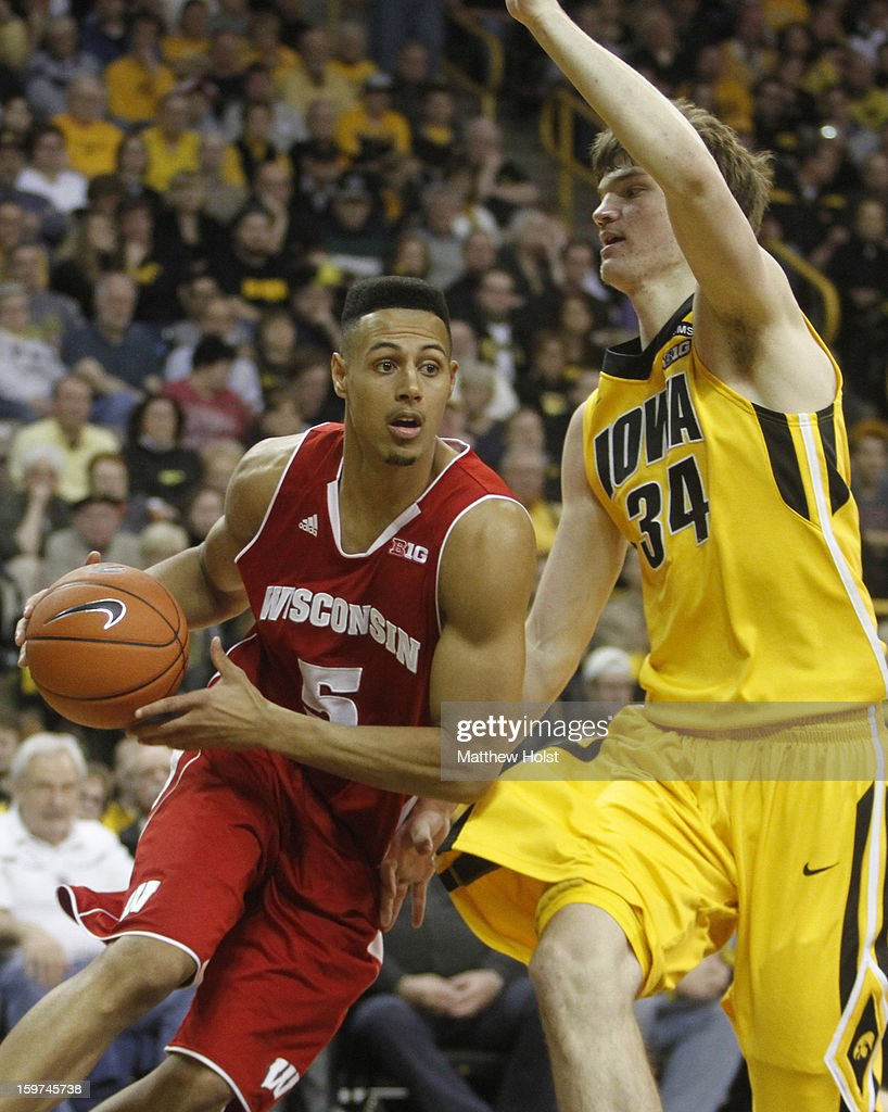 Guard Ryan Evans #5 of the Wisconsin Badgers drives to the basket during the first half against center Adam Woodbury #34 of the Iowa Hawkeyes on January 19, 2013 at Carver-Hawkeye Arena in Iowa City, Iowa.