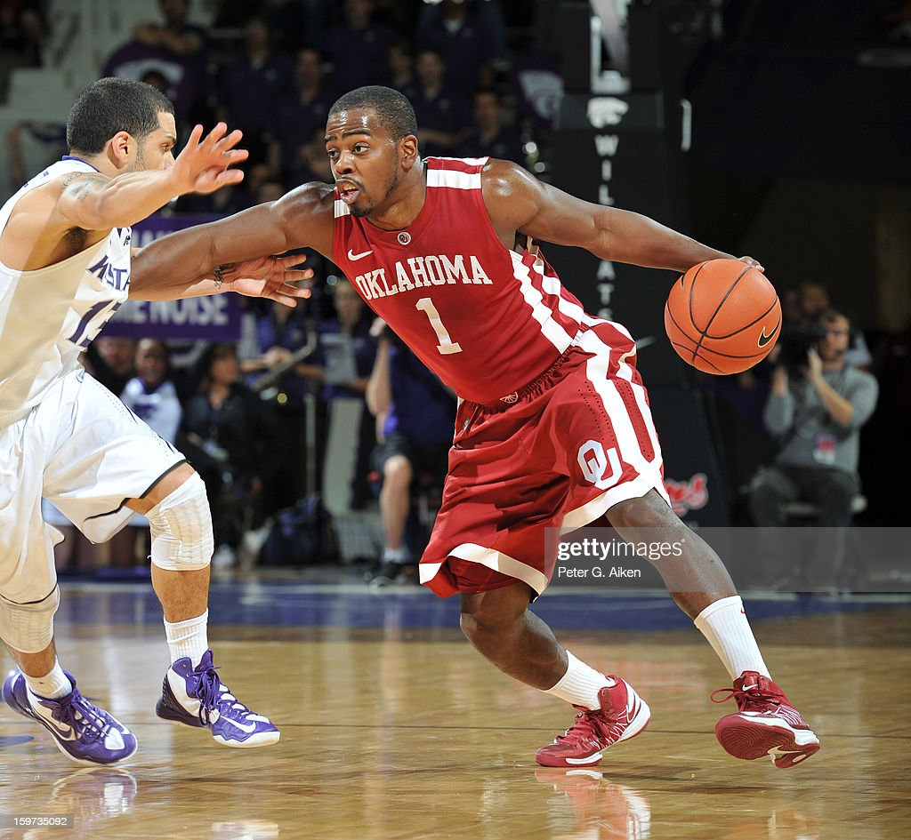 Guard Sam Grooms #1 of the Oklahoma Sooners brings the ball up court against guard Angel Rodriguez #13 of the Kansas State Wildcats during the first half on January 19, 2013 at Bramlage Coliseum in Manhattan, Kansas. Kansas State defeated Oklahoma 69-60.