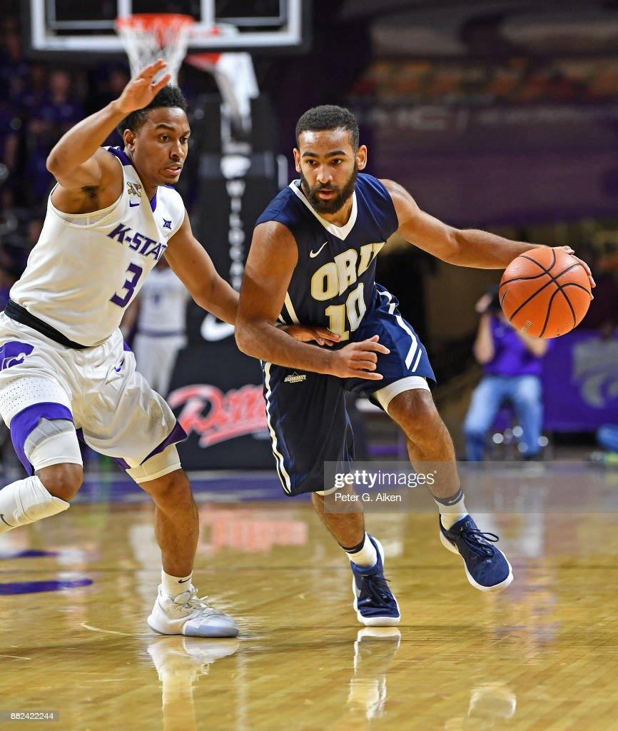 Guard Sam Kearns #10 of the Oral Roberts Golden Eagles dribble up court against guard Kamau Stokes #3 of the Kansas State Wildcats during the first half on November 29, 2017 at Bramlage Coliseum in Manhattan, Kansas.